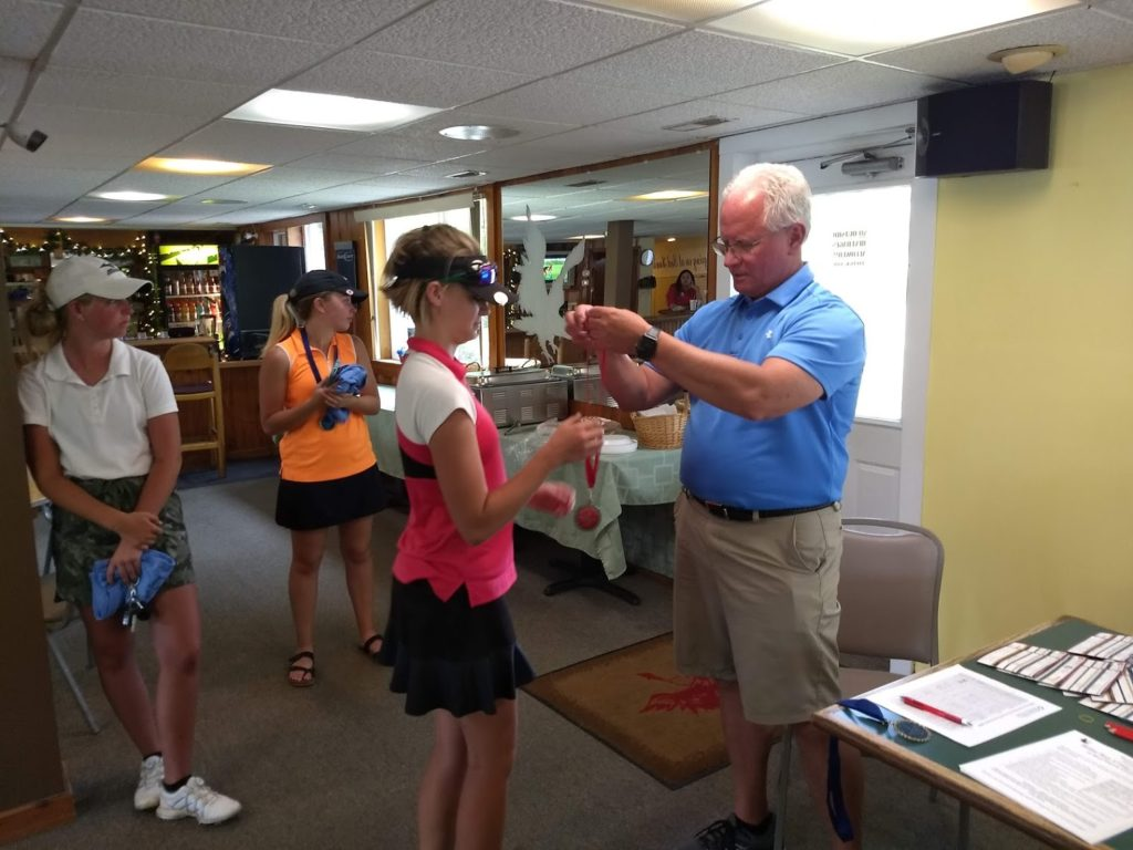Wes Choate gives Jaylee Glenn her second place award