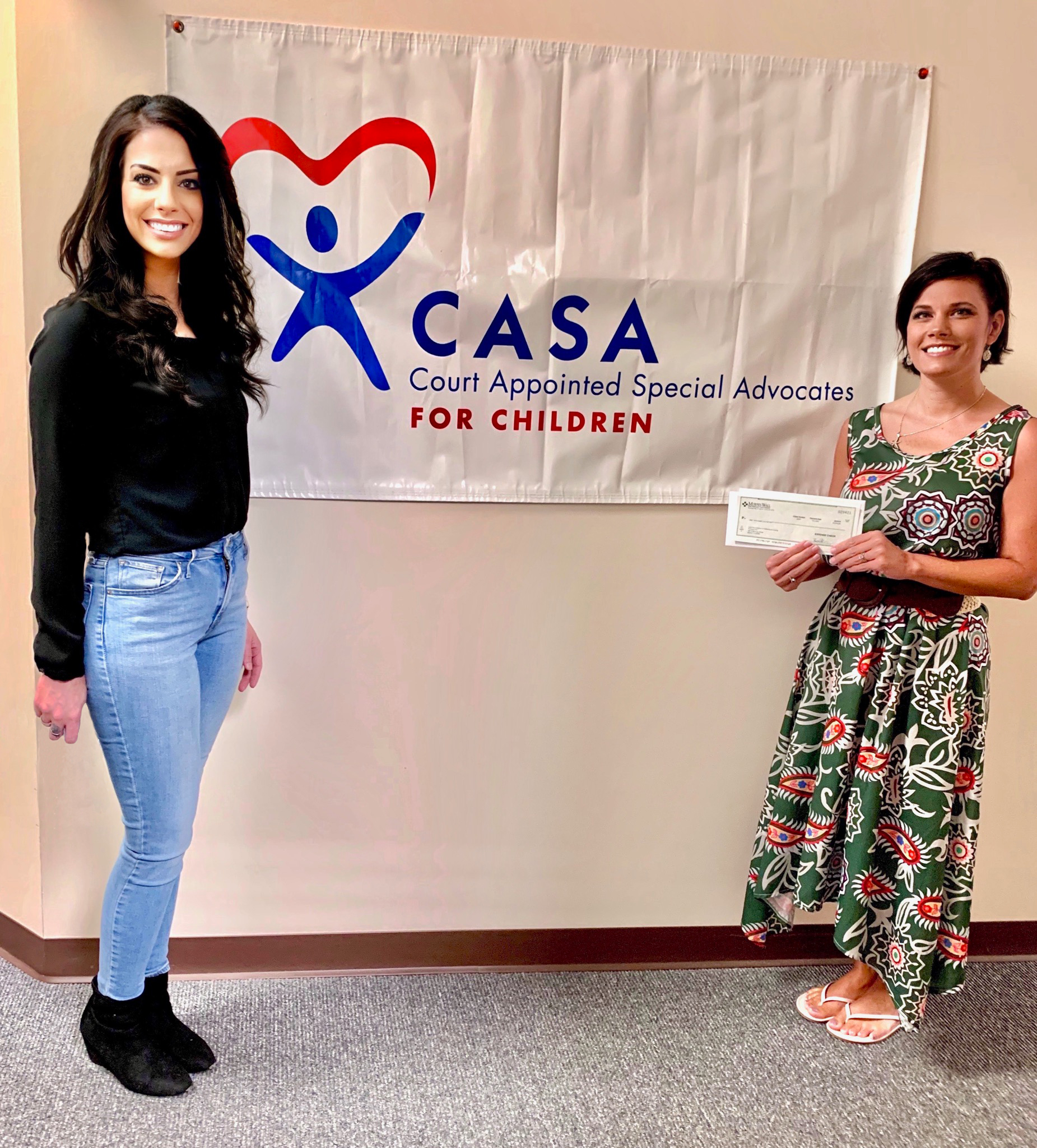 Murphy-Wall State Bank AVP/Branch Manager Bailey Thompson gives Casa of Williamson County (Court Appointed Special Advocates) Executive Director Nannette Vaughn a COVID-19 Relief donation from the FHLB of Chicago