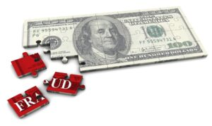 "One hundred dollar bill broken into puzzle pieces that say ""Fraud"""