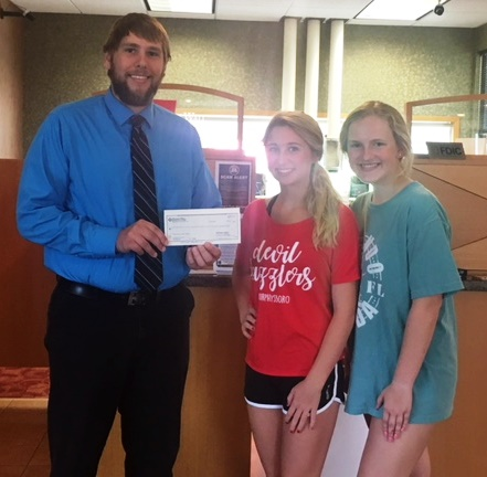 Murphy-Wall State Bank and Trust Company give Murphysboro Devil Dazzlers a donation
