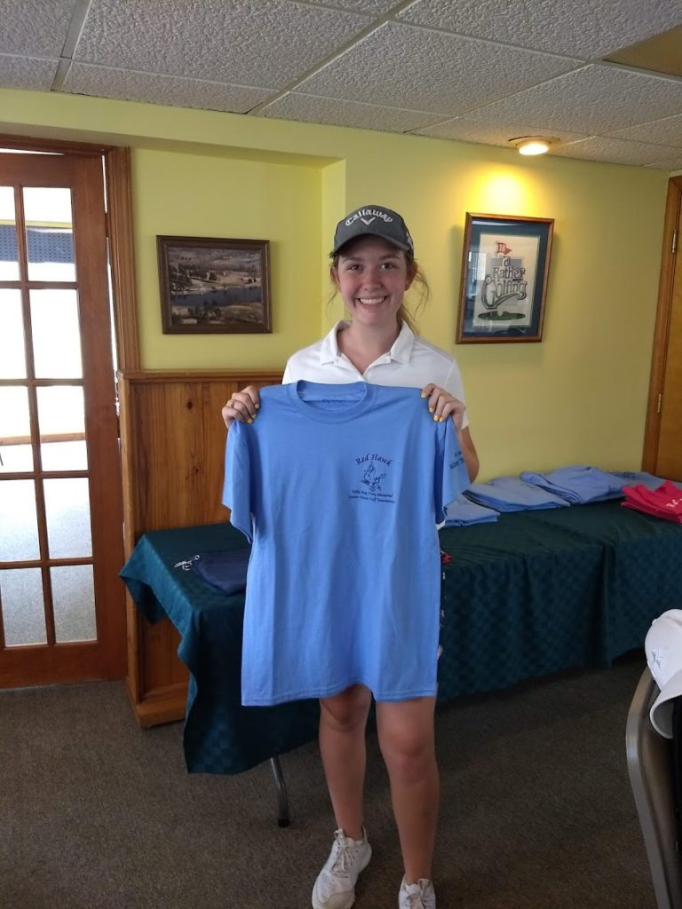 Elizabeth Eastham shows her Murphy-Wall sponsored shirt