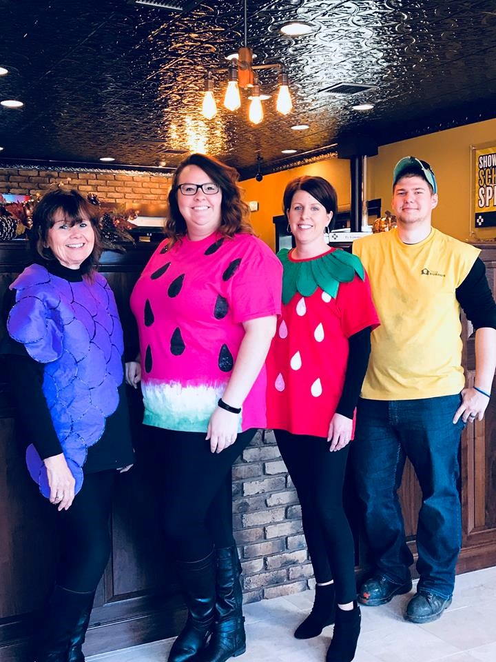 Muprhy-Wall State Bank and Trust Company employees dress up as fruit and farmer for 2017 Halloween