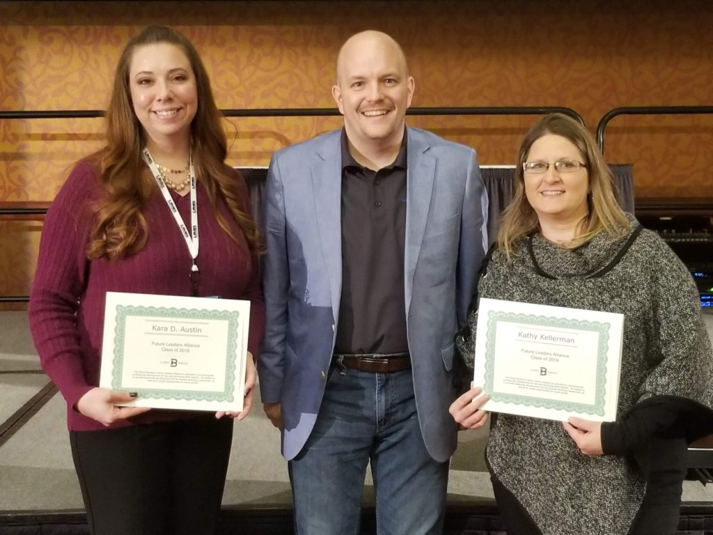 Upon their recent course completion, Future Leaders Alliance (FLA) Graduates Kara D. Austin and Kathy Kellerman of Murphy-Wall State Bank stand with Callan E.H. Stapleton, FLA Leader, Vice President Education Services and Products & Services.