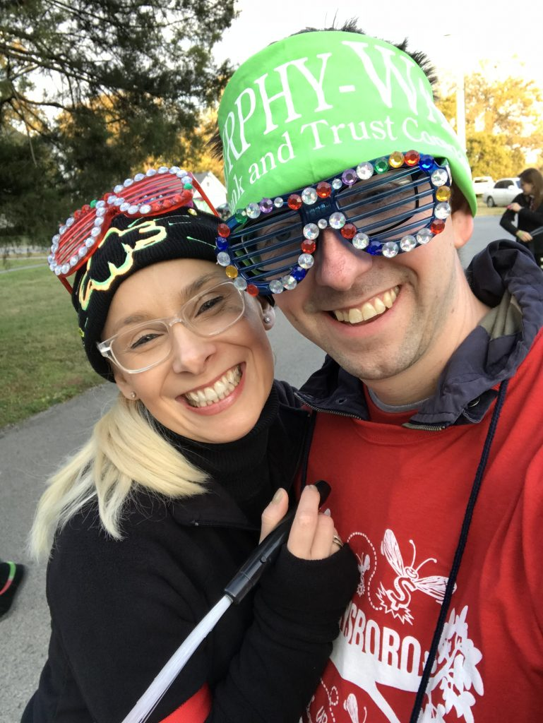 Murphy-Wall employees Eric Lambert and Monika Holder have fun at the 2018 Mardi Gras