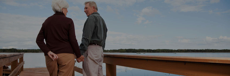 elderly couple looking at the ocean