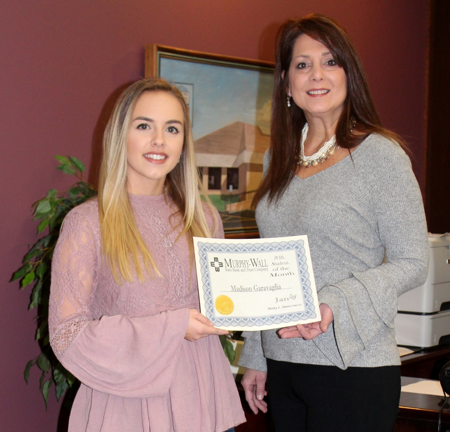Murphy-Wall State Bank and Trust Company COO Susan Davis gives PCHS student Madison Garagvalia the 2018 January Student of the Month award