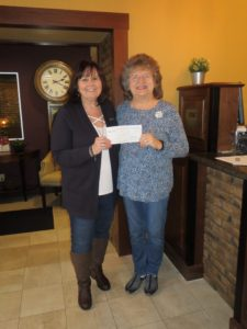Murphy-Wall State Bank VP Julie Briley gives Mary Ann Horstmann a check for the Elverado Education Foundation