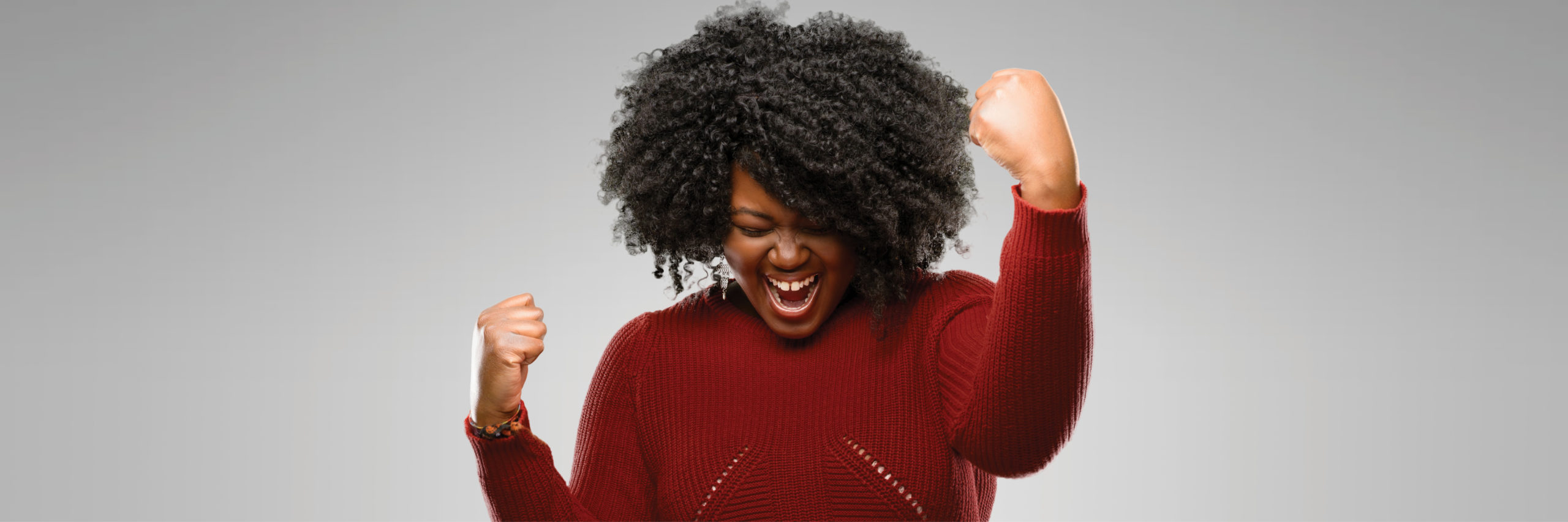 Woman excited and happy with fists in the air