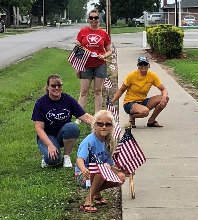 Murphy-Wall State Bank and Trust Company employees putting flags out for 2018 Independence Day in Pinckneyville IL