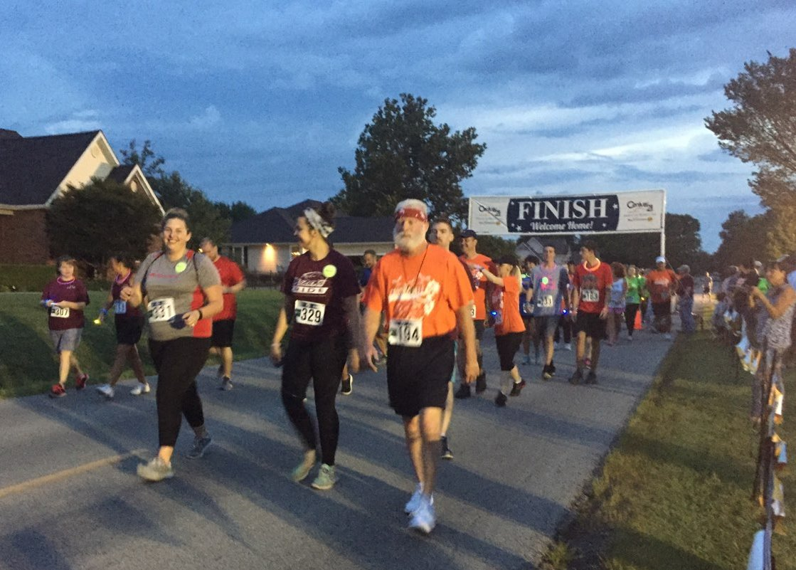 Runner/walkers in the beginning of the Carterville Chamber's Glo 5K Run/Walk
