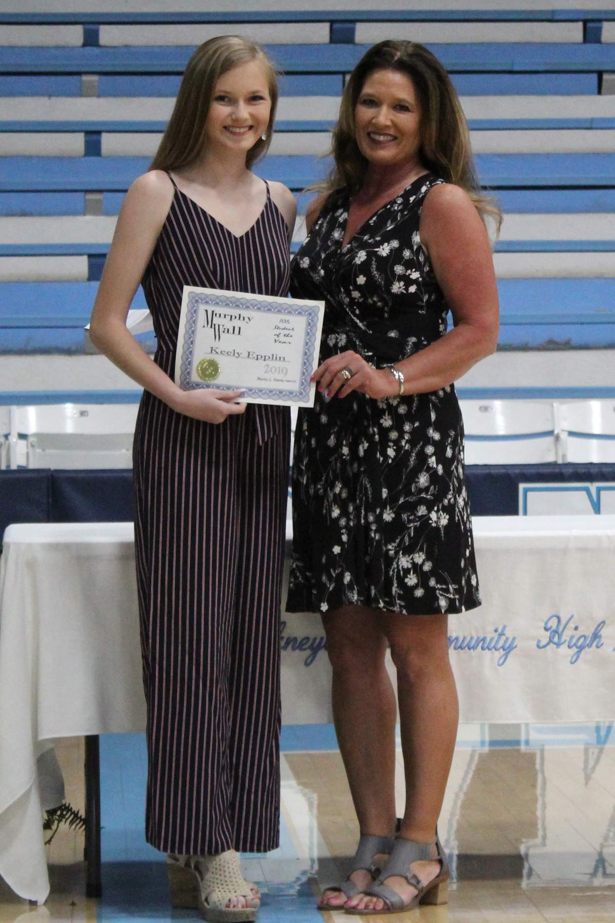 Murphy-Wall State Bank employee give PCHS student Keely Epplin the Student of the Year Award