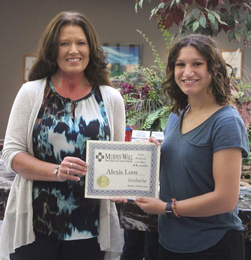 Lexi Loos, Murphy-Wall State Bank's October PCHS Student of the Month; receiving her certificate from Candice Knight VP/Retail Banking Officer
