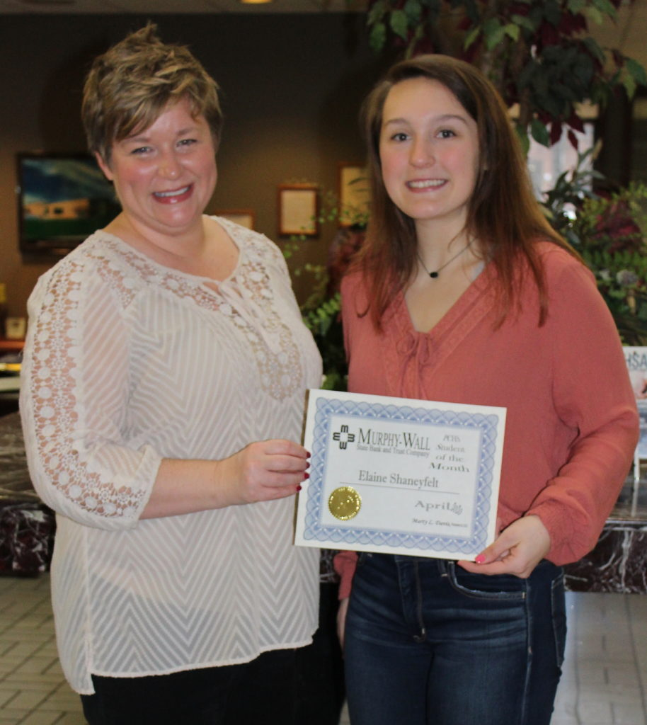Murphy-Wall employee Angie WIlliams give PCHS student Elaine Shaneyfelt the April Student of the Month award