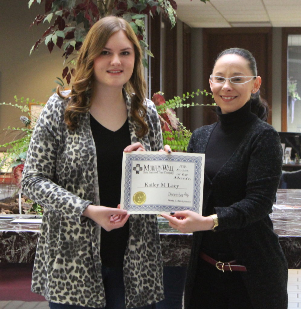 Murphy-Wall State Bank Employee Monica Holder give PCHS student Kailey Lacy the 2019 December Student of the Month Award