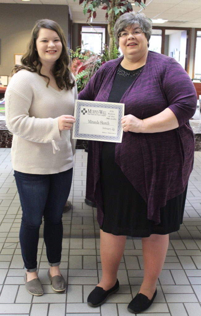Murphy-Wall VP Meschelle Brand give PCHS student Miranda Skorch the February Student of the Month Award