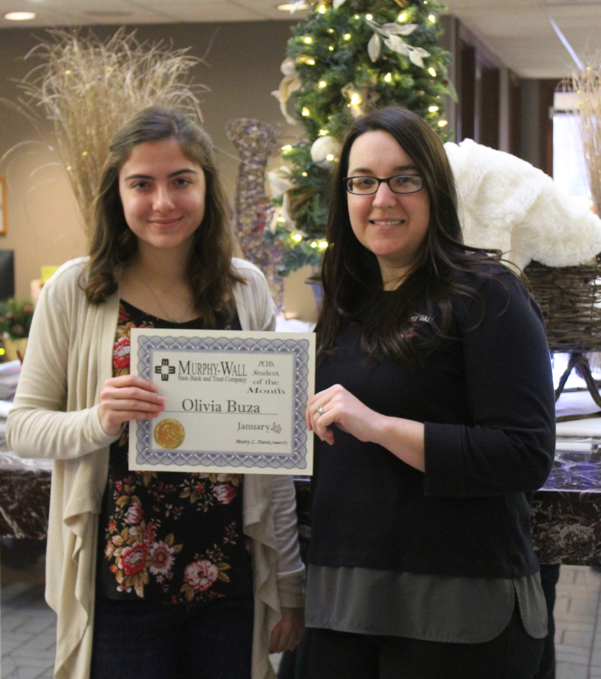 PCHS January 2019 Student of the Month, Olivia Buzza, is pictured receiving her certificate from Denise Smith, Murphy-Wall State Bank Teller Supervisor/Cash Services/Marketing Team Member
