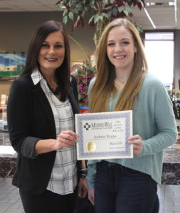 Murphy-Wall employee Jenn Tritschler give PCHS student Aubrey Bruns the 2019-2020 March Student of the Month Aware