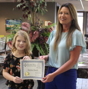 Murphy-Wall State Bank VP Candice Knight gives PCHS student Martina Skorch the 2019 September Student of the Month Award