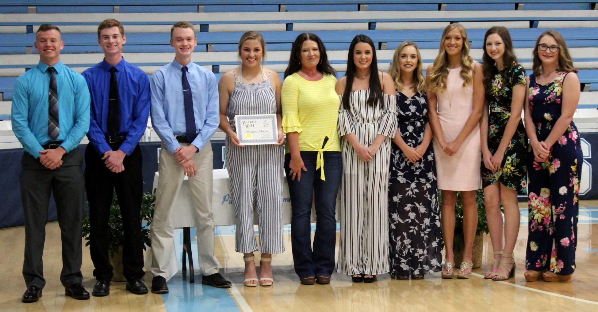 PCHS 2018 Student of the Month students Ryan Brueggemann, Stephan Wagner, Justin Keller, Megan Mayo, Hannah Epplin, Madison Garagavalia, Shania Opp, Abi West, and Sydney Caccioppo pose with Murphy-Wall State Bank and Trust Company VP Candice Knight