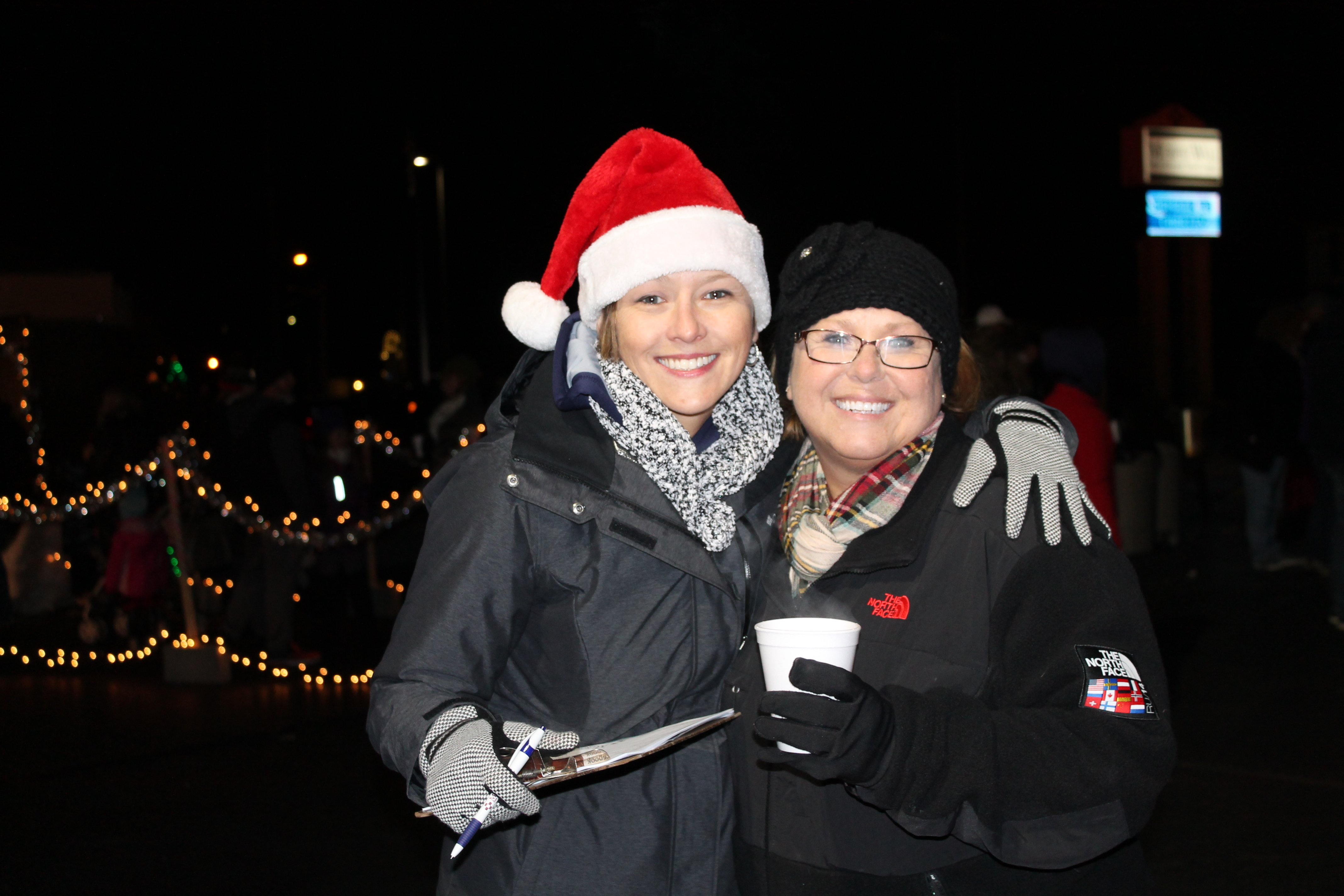 Murphy-Wall State Bank and Trust Company employees VP Sarah Folden and VP Claudia Choate smile for the event