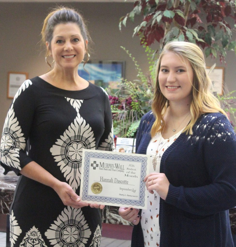 Murphy-Wall State Bank and Trust Company COO Susan Davis give PCHS student Hannah Dascotte the 2018-19 Student of the Month September award