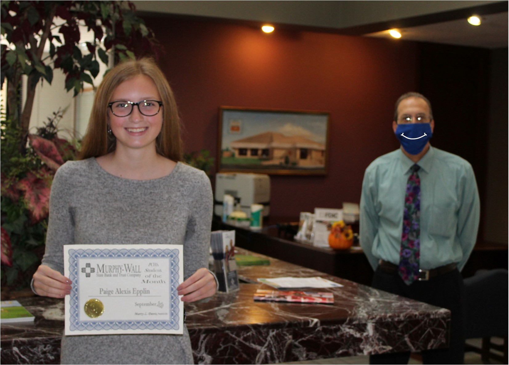 Murphy-Wall employee, Barry Kellerman, gives PCHS student, Paige Epplin, the 2020 September Student of the Month Award