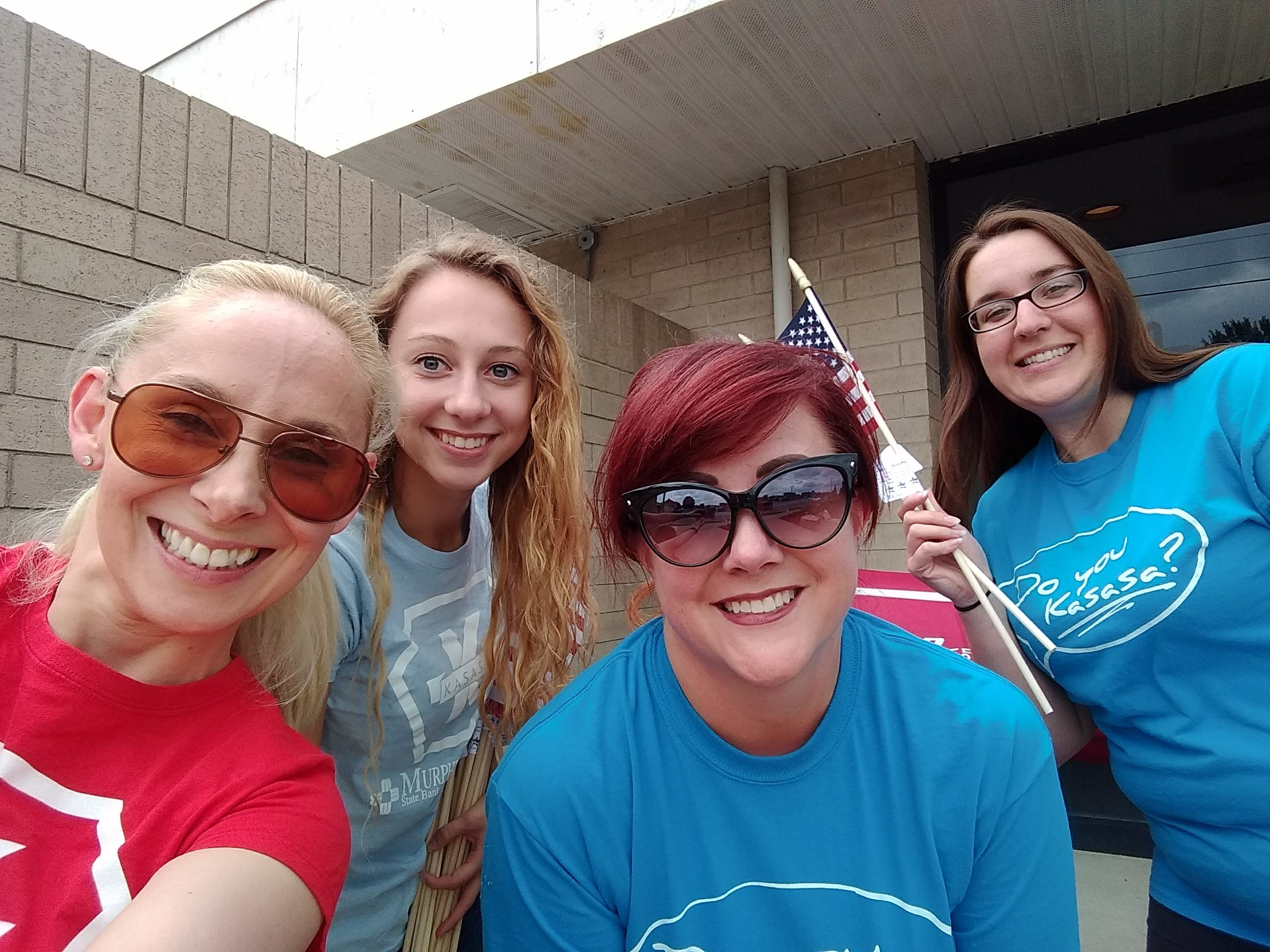 Murphy-Wall State Bank and Trust Company employees pose for a quick picture before putting flags out for 2018 Independence Day