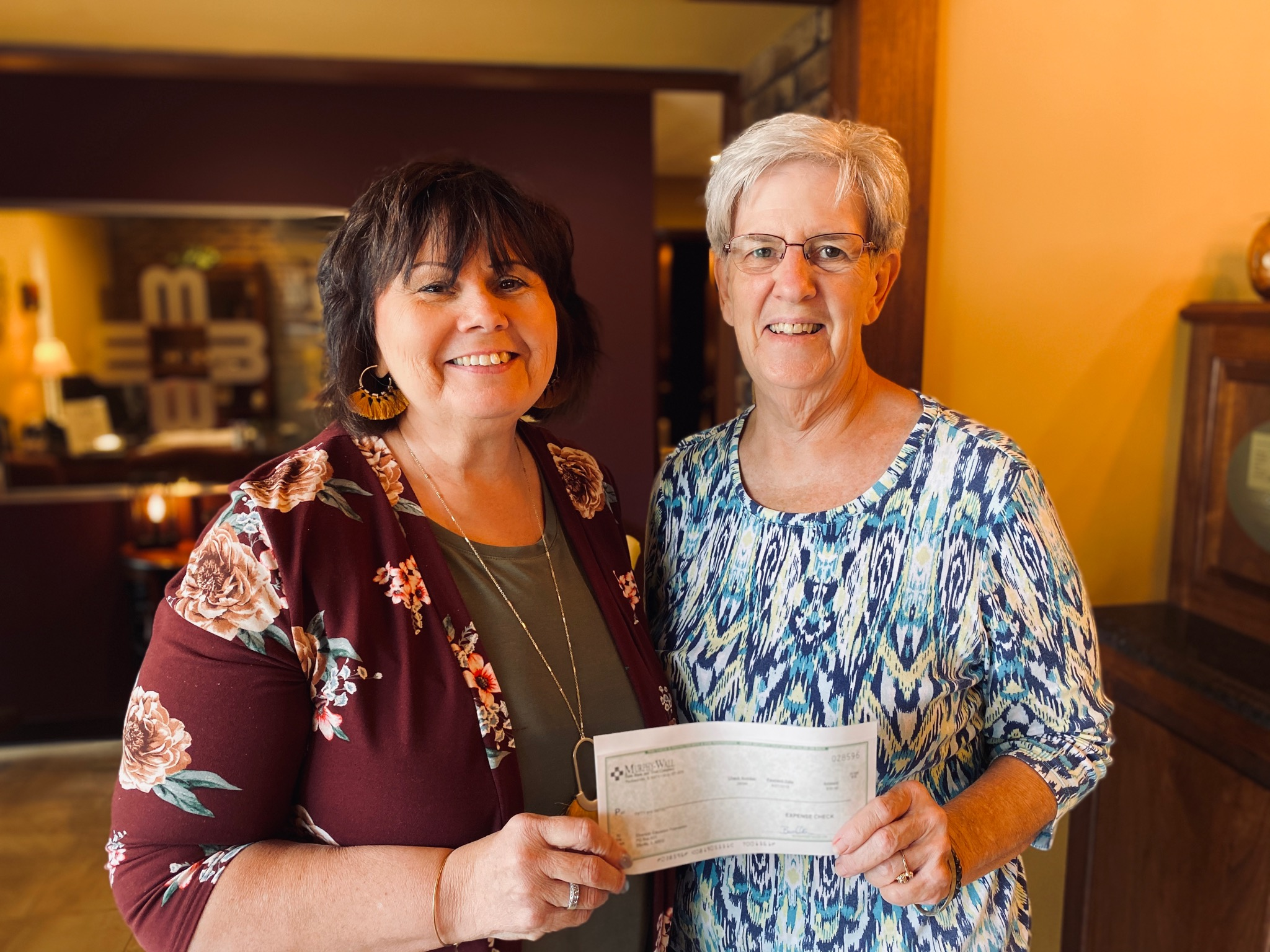 Julie Briley, Elkville Branch Manager, Murphy-Wall State Bank is pictured presenting a donation from the bank for the Elverado Education Foundation's upcoming 5K Walk/Run to Foundation Vice President Wilma Coffer-Westerfield.