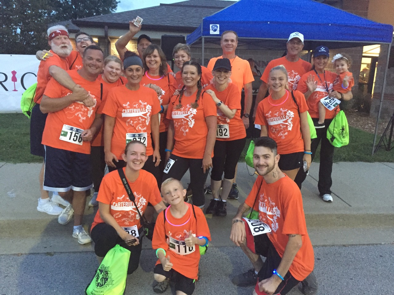 A group of Murphy-Wall State Bank and Trust Company gather for a picture before the 2018 Carterville Chamber's Glo 5K Run/Walk