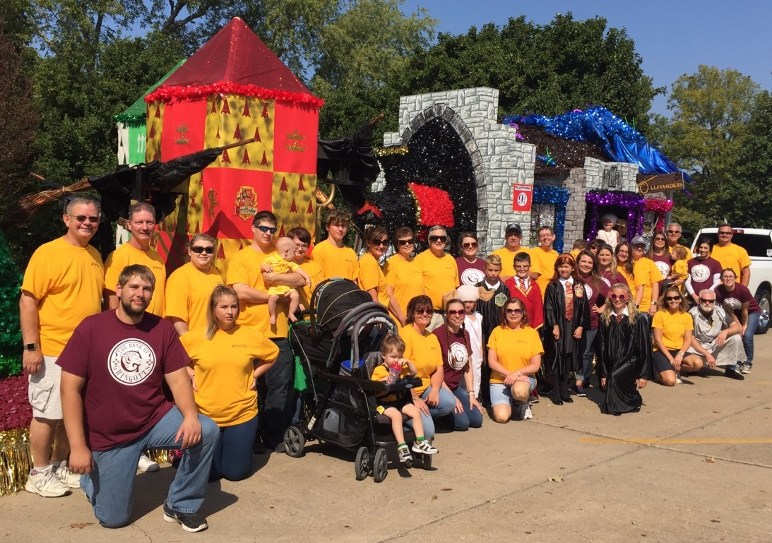 Murphy-Wall State Bank and Trust Company employees walking next to the float in the Apple Festival