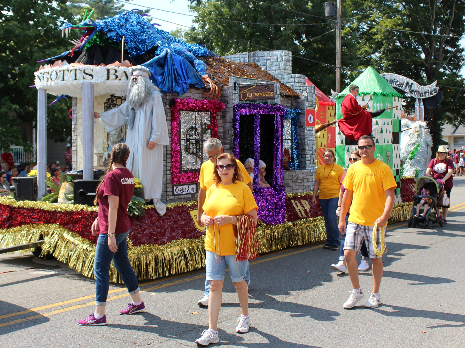 Murphy-Wall employees walking next to the float in the Apple Festival