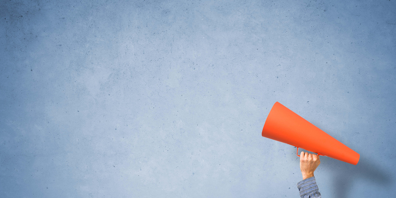 Picture of orange megaphone on blue background