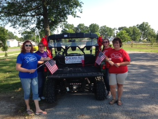 Murphy-Wall State Bank Employees pose with flags that were placed for July 4th