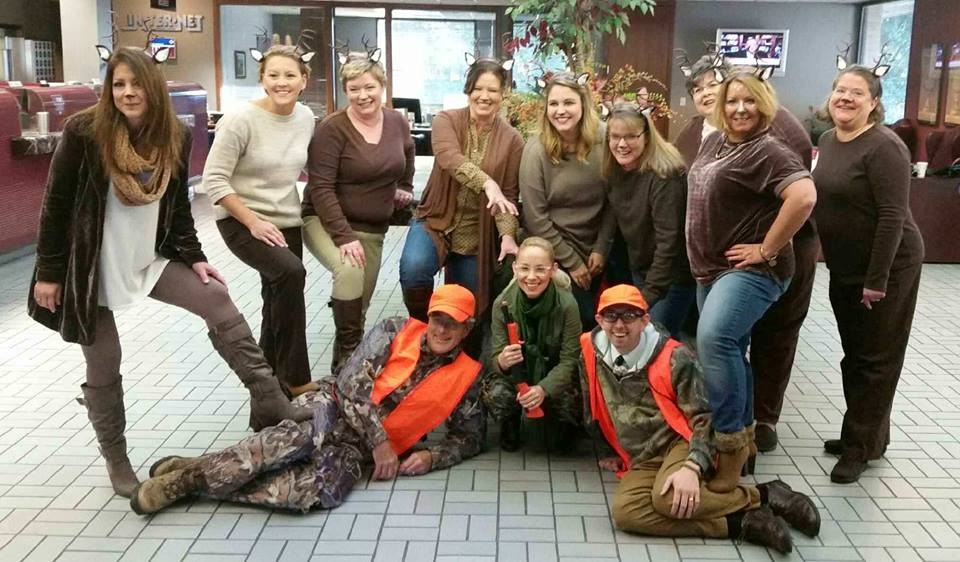 Murphy-Wall State Bank employees dress up as deer and hunters for 2017 Halloween