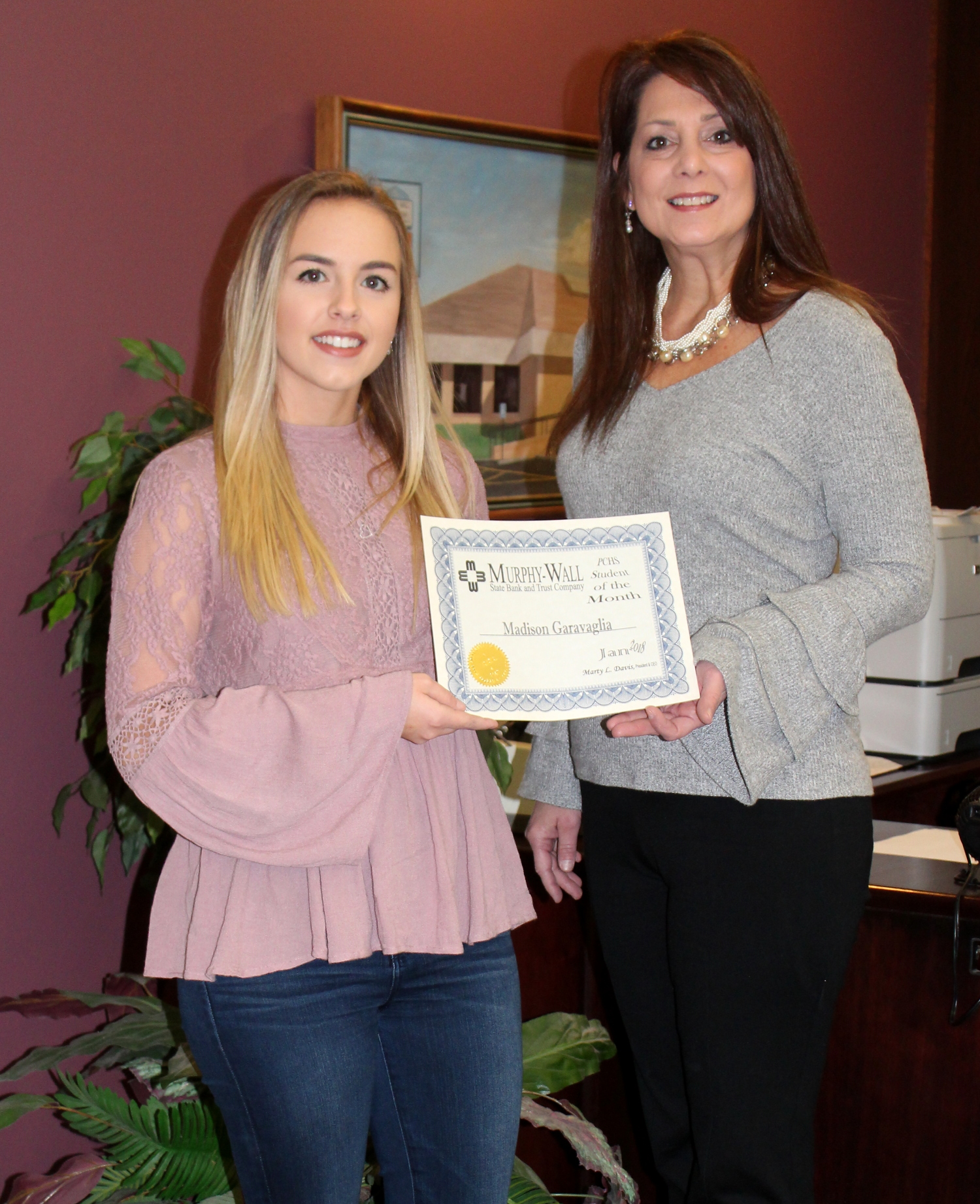 Murphy-Wall Vice President Susan Davis give Student of the Month awayd to PCHS Student Madison Garavaglia